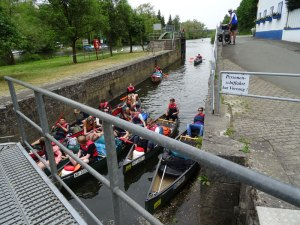 A group of canoeists entering a manually operated lock.
